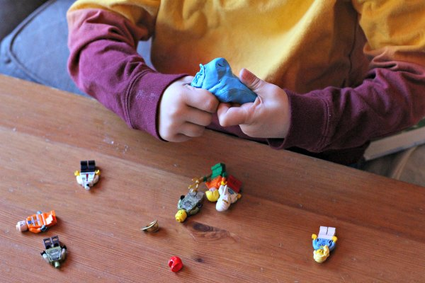 Fine motor activity with LEGO and putty.