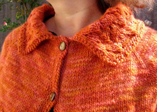 The lovely orange shrug, detail view