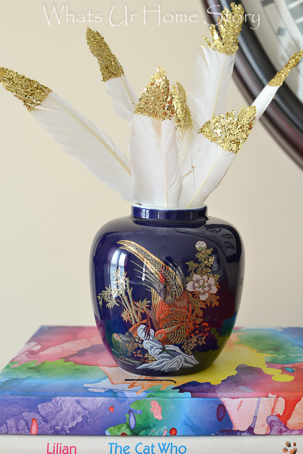 A simple and easy party senterpiece - a bowl fille dwith glitter dipped feathers