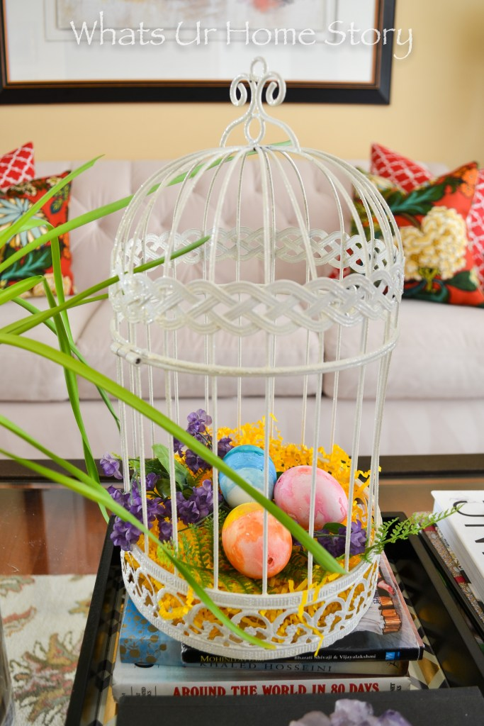 5 ways to decorate with Easter eggs - Eggs in bird cage Spring vignette