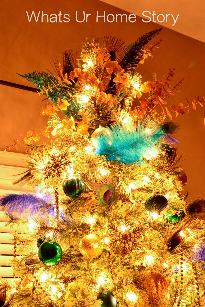 peacock-themed-christmas-tree-topper-with-feathers