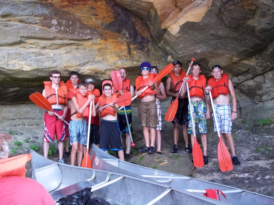 our group - posing at the cave carved into the bank