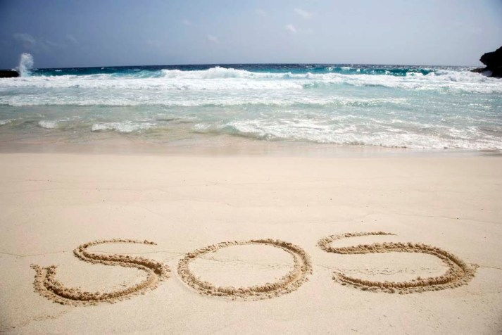 SOS sign on beach