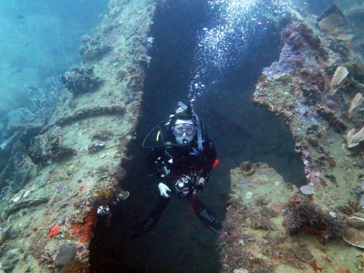 8483-Deb-in-the-crack-down-the-hull-diving-I-1-Submarine-at-Honiara-Solomon-Islands-Diveplanit-8483
