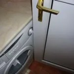Door-catches-on-washing -machine