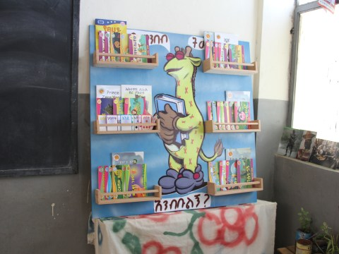 A Tsehai Reading Corner featuring Tsehai storybooks, flashcards, and and posters to encourage childhood literacy in Ethiopian schools