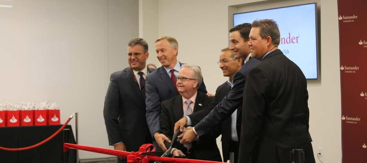 City of Mesa Mayor John Giles and Vice Mayor Dennis Kavanaugh take part in ribbon cutting ceremony for Santander Consumer USA.