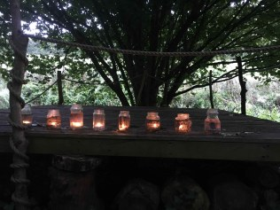 Tealights lighting up the wooded glade at Wilton Farm campsite