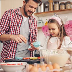 father and daughter baking