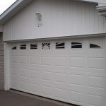 white-garage-door-with-raised-panels-specialty-windows-milton