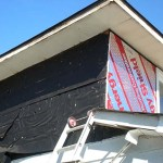 During: Remove old siding insulate