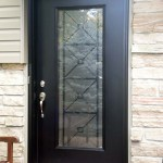 Oversized front door with wrought iron insert