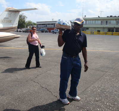 Photo: Ex-FIFA vice-president Jack Warner delivers bottled water to Haiti. FIFA and the Haitian football president accused him of failing to pass on the money, though.
