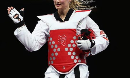 LONDON, ENGLAND - AUGUST 10:  Carmen Marton of Australia celebrates beating Sousan Hajipourgoli of Iran during the Women's -67kg Taekwondo Preliminary Round on Day 14 of the London 2012 Olympic Games at ExCeL on August 10, 2012 in London, England.  (Photo by Hannah Peters/Getty Images)