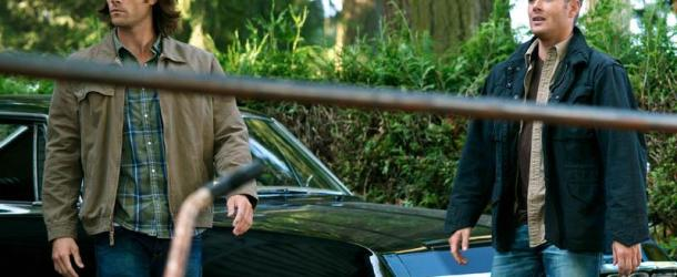 spn s8 e01 sam and dean walking away from impala