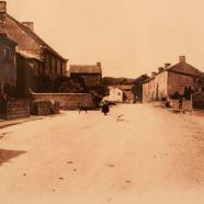 The shop (left) and Main Street in 1911