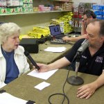 Tom Berg talks to Joan Haugh about the need of donations at the Community Services of Starke County Food Pantry
