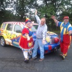 WKVI's Tom Berg clowns around with Carlee and Charley from the Kelly Miller Circus.