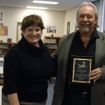 Superintendent Lynn Johnson presented Principal Michael McBride with a plaque honoring the elementary school's efforts.