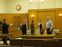 Judge Kim Hall swore in new CASA members Rebecca Berg, Patricia Camp, Katlyn Foust, and John Wampler.
