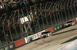 Kevin Harvick, driver of the #4 Budweiser Chevrolet, takes the checkered flag to win the NASCAR Sprint Cup Series Bojangles' Southern 500 at Darlington Raceway on April 12, 2014 in Darlington, South Carolina. Photo by Getty Images