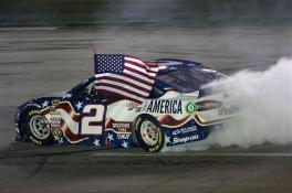 Brad Keselowski, driver of the #2 Miller Lite Ford, celebrates with a burnout after winning the NASCAR Sprint Cup Series Quaker State 400 presented by Advance Auto Parts at Kentucky Speedway on June 28, 2014 in Sparta, Kentucky. Photo by Todd Warshaw/Getty Images