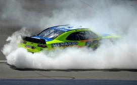 Paul Menard, driver of the #33 Nibco/Menards Chevrolet, celebrates with a burnout after winning the NASCAR Nationwide Series Ollie's Bargain Outlet 250 at Michigan International Speedway on June 14, 2014 in Brooklyn, Michigan. Photo by Patrick Smith/Getty Images