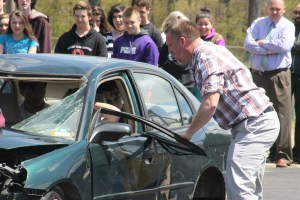 Oregon-Davis teacher and coach Wes Radke was the first to arrive at the site of the mock crash staged in the high school parking lot.
