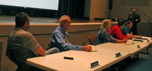 Board members listen as Nathan P. Origer makes the case for keeping an appointed board.