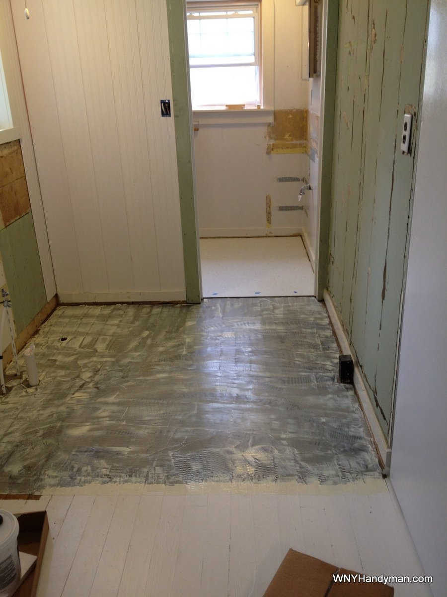 How to put floor tiles down