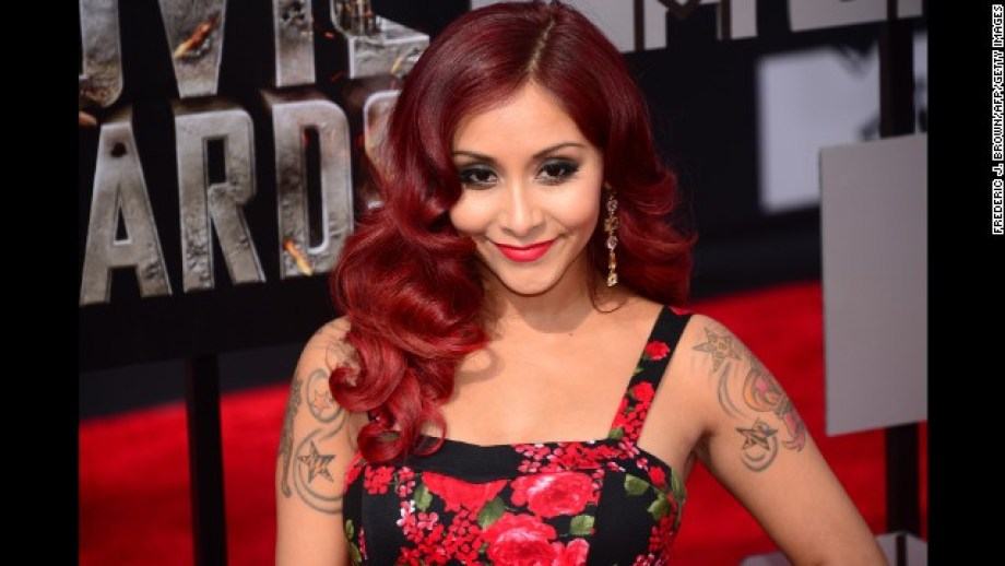 Snooki from 'Jersey Shore' arrives on the red carpet for the 2014 MTV Movie Awards at the Nokia Theater in Los Angeles, California, on April 13, 2014.   AFP PHOTO / Frederic J. BROWN        (Photo credit should read FREDERIC J. BROWN/AFP/Getty Images)