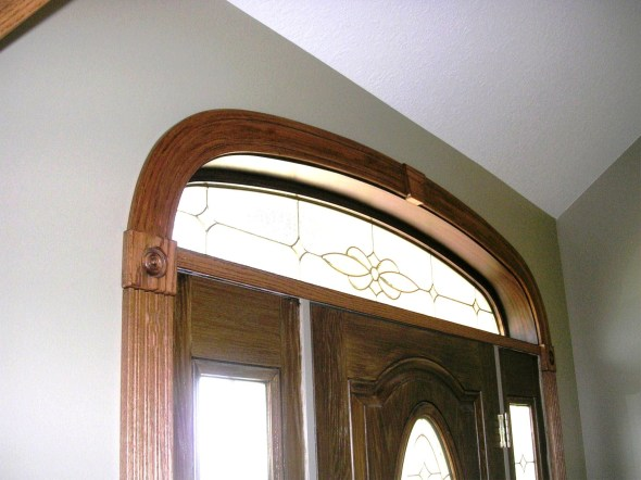 This is a photo of an elliptical molding over a front door with two side lights. This is the most popular elliptical shape. The elliptical moldings offered by the window and door companies often only offer this molding in fingerjoint moldings which come in pieces. The Curved Molding Shop offers all standard profiles as well as custom profiles for this shape of elliptical. Everything shown here was run on the 718 Woodmaster.