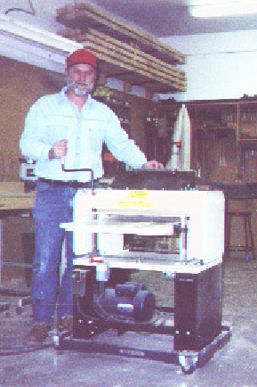 """Here's Walter Ostrander in his shop with his Woodmaster. """"It paid for itself in about a year,"""" he says. Now he wants a bigger one."""