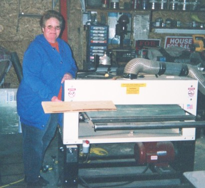 "Earl asked Mrs. Bryam to step in while he snapped the photo of his Woodmaster. ""I buy American whenever I can."""