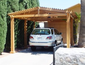 Ed built this pergola as a home for his auto. Slatted roof provides good ventilation and protection from the hot Texas sun.