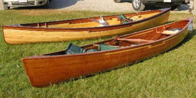 Here are two cedar canoes Chuck and Dale built. They built the one in the foreground with commercial cedar strips. They made their own strips for the one in the back. Why'd they start making their own? When they realized how much they were spending on cedar strips they got a Woodmaster Molder Planer and made their own.