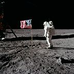 """Buzz salutes the U.S. Flag"" by NASA Licensed under Public domain via Wikimedia Commons"