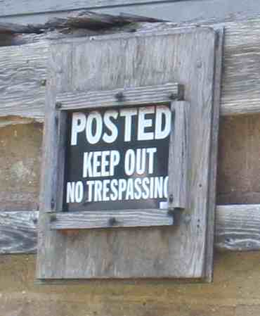 no trespassing sign capitalim