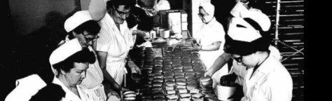 Preparing cheeseburgers work labor aseembly line fast food