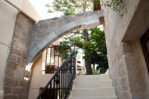 pillow tied to an archway in Rhodes Old Town - @World Travel Mama
