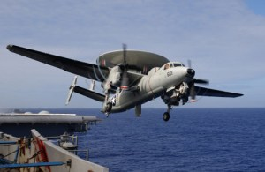 U.S. Adm. John Richardson boarded an E-2C from the carrier USS Stennis to inspect disputed South China Sea area.