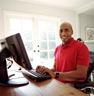 man typing on computer for freelance clients