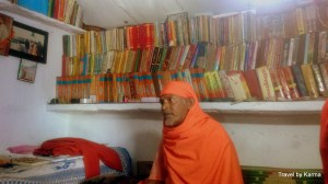 Shankar Swamyji in his small room with his books and Maa Kali