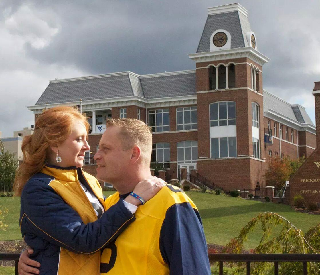 Shalee and Scott in front of the WVU Alumni Center