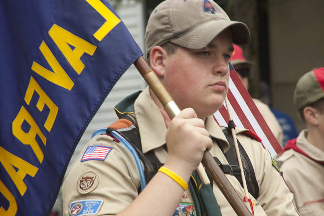 boyscout with troop banner