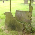 Broken gravestone in several pieces.