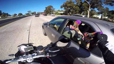 Motorcyclist touches feet on the freeway