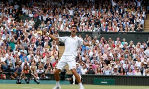 Novak Djokovic of Serbia celebrates winning the men's singles final against Roger Federer of Switzerland at the All England Lawn Tennis Championships in Wimbledon, London, Sunday July 12, 2015. Djokovic won the match 7-6, 6-7, 6-4, 6-3. (AP Photo/Alastair Grant) ORG XMIT: WIM265