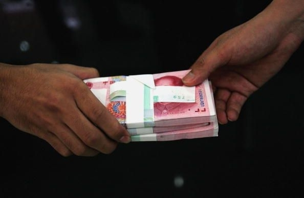 China Scraps Yuan Peg To US dollar
