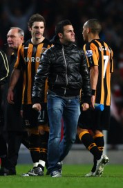 Cesc Fabregas passes Hully City Assistant Manager Brian Horton after coming onto the pitch after the the FA Cup Sponsored by E.on sixth round match between Arsenal and Hull City at Emirates Stadium on March 17, 2009 in London, England.  (Photo by Ryan Pierse/Getty Images) *** Local Caption *** Cesc Fabregas;Brian Horton